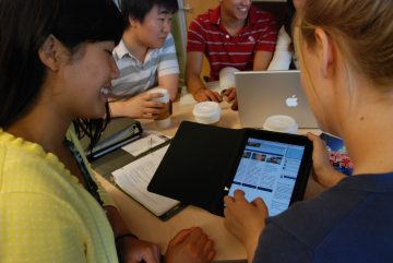 students studying with ipad and laptop